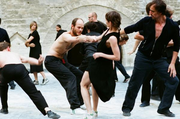 Rosas during performance of Cesena at the Palais des Papes in Avignon. Photo © Anne Van Aerschot. Pictured: dancers Carlos Garbin (left centre) and Marie Goudot (right centre).