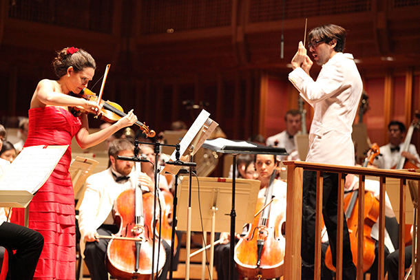 Daniel Cohen leading the TMCO and violinist Sarah Silver in Mackey's Beautiful Passing. Photo Hilary Scott.