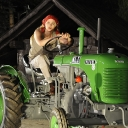 2. Wally enters on a vintage tractor.