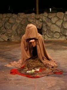 "Carmen studies her future in Peter Brook's ""La Tragédie de Carmen"""