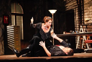 Floria Tosca (soprano Jill Gardner) makes a drastic decision to protect herself and her love from Baron Scarpia (bass-baritone Bradley Garvin). Photo Jeffrey Dunn for Boston Lyric Opera © 2010.