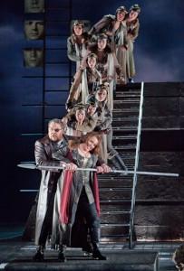 Die Walküre, Act III: Mark Delavan (Wotan) and Nina Stemme (Brünnhilde) with the Valkyries. Photo Cory Weaver.