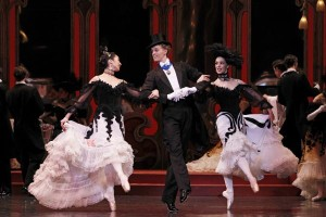 Natasha Kusen, Adam Bull and Amy Harris as guests at Chez Maxime in Act III of The Merry Widow. Photo: Jeff Busby.