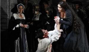A tortured Smeaton (Tamara Mumford) confesses all to Anna Bolena (Anna Netrebko)