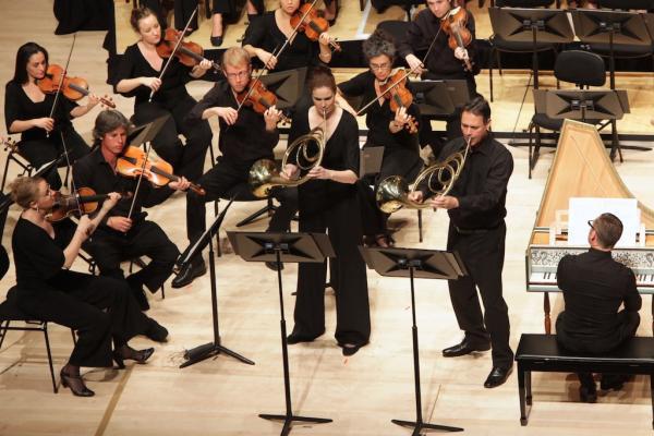 Dorée Dixon and Darryl Poulsen play horns for the Telemann concerto. Photo by Steven Godbee.