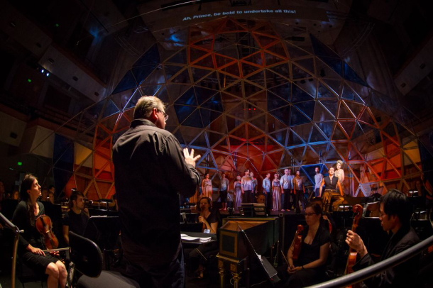Antony Walker conducts the Orchestra of the Antipodes for the Pinchgut Opera's Caster & Pollux with Andy McDonell's set in background. Photo by Simon Hodgson.