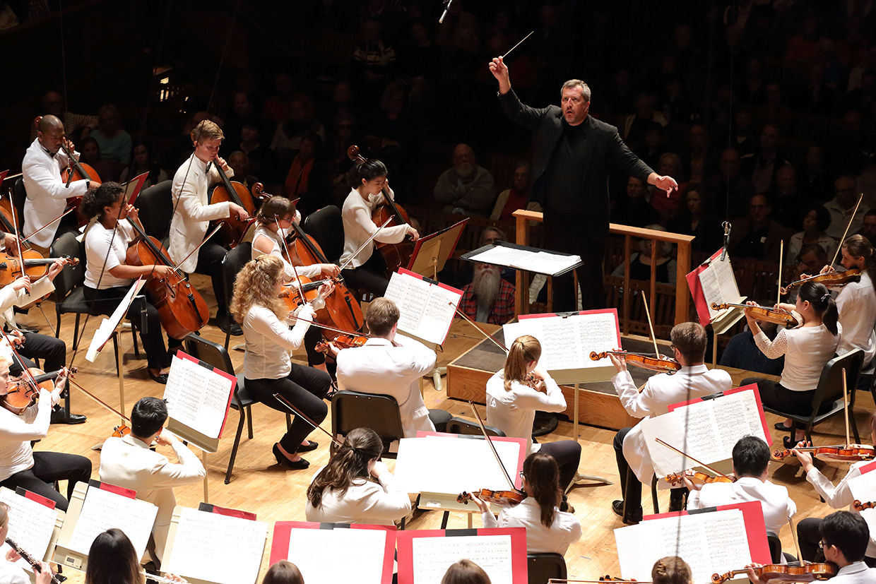 Thomas Ades leads the TMC Orchestra. Photo Hilary Scott.