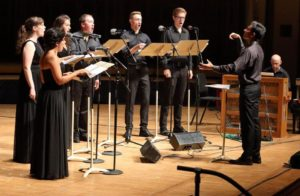 """Vinay Parameswaran leads Festival of Contemporary Music cocurator Jacob Greenberg and Tanglewood Music Center Fellows in Nathan Davis's """"The Sand Reckoner"""". Photo Hilary Scott."""