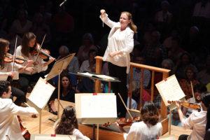 Conducting Fellow Gemma New conducts the TMC Orchestra. Photo Hilary Scott.