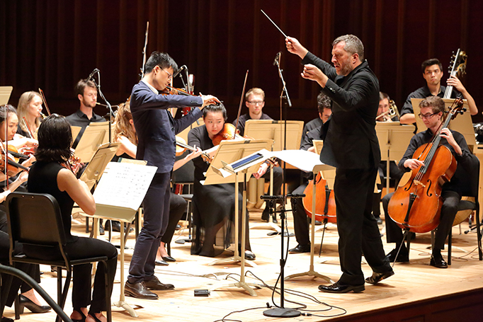 Chi Li performs Francisco Coll's Four Iberian Miniatures under the direction of Thomas Adès at the Festival of Contemporary Music at Ozawa Hall at Tanglewood 7.26.18. Photo Hilary Scott.
