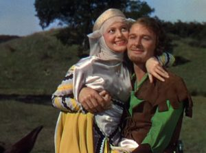 Olivia de Havilland (Maid Marian) and Errol Flynn (Robin Hood) in The Adventures of Robin Hood.